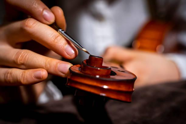 violin maker at work in her workshop